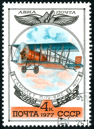 USSR - CIRCA 1977: A stamp printed in the USSR, shows a biplane P-4 BIS, 1917, circa 1977 Editorial