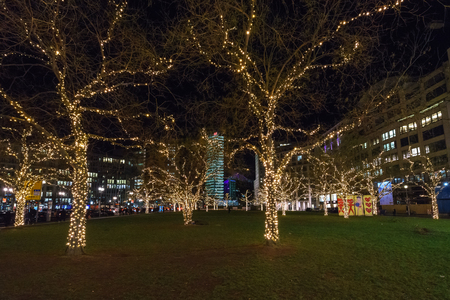 BERLIN - DECEMBER 18, 2017: Decorated for Christmas with brightly colored garlands of trees at Leipziger Platz.