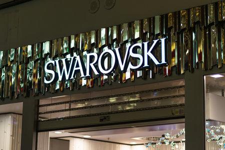 BERLIN - DECEMBER 18, 2017: Swarovski logo in the Arkaden shopping mall at Potsdamer Platz. Swarovski is an Austrian producer of luxury cut lead glass (crystal).