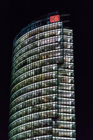 BERLIN - DECEMBER 18, 2017: Potsdamer Platz. Headquarters of Deutsche Bahn (main railway operator) in the night illuminations. Height 103 m, architect Helmut Jahn.