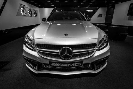 BERLIN - DECEMBER 21, 2017: Showroom. Mid-size car Mercedes-Benz C-Class AMG C63 (W205). Black and white. Since 2015. Sajtókép