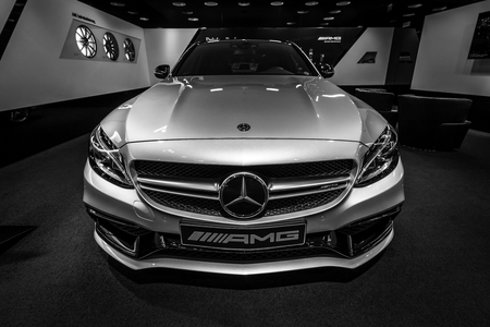 BERLIN - DECEMBER 21, 2017: Showroom. Mid-size car Mercedes-Benz C-Class AMG C63 (W205). Black and white. Since 2015. Editoriali