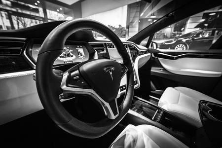 BERLIN - DECEMBER 21, 2017: Showroom. Interior of the full-sized, all-electric, luxury, crossover SUV Tesla Model X. Produced since 2016. Black and white. Editorial