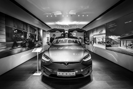 BERLIN - DECEMBER 21, 2017: Showroom. The full-sized, all-electric, luxury, crossover SUV Tesla Model X. Produced since 2016. Black and white.