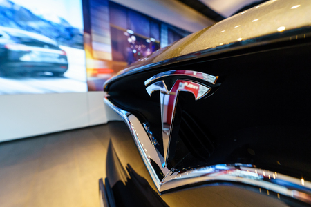 BERLIN - DECEMBER 21, 2017: Showroom. The emblem of the full-sized, all-electric, luxury, crossover SUV Tesla Model X. Produced since 2016.
