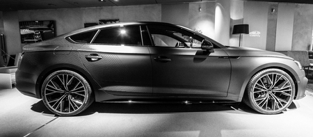 BERLIN - DECEMBER 21, 2017: Showroom. Compact executive car Audi A5 Sportback g-tron. Since 2017. Black and white. Editorial