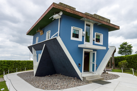 USEDOM, GERMANY - JULY 18, 2017: Upside Down House. Popular among the guests of the Usedom Island is a tourist attraction