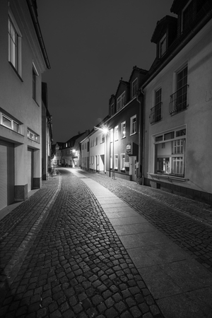 SENFTENBERG, GERMANY - FEBRUARY 08, 2018: Night streets of the old town. The ancient city of Senftenberg. Federal state of Brandenburg. First mentioned in chronicles in 1276. Black and white. Editorial