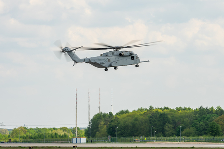 BERLIN, GERMANY - APRIL 27, 2018: Take off the heavy-lift cargo helicopter Sikorsky CH-53K King Stallion. Exhibition ILA Berlin Air Show 2018 Editorial
