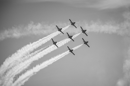 BERLIN, GERMANY - APRIL 28, 2018: Demonstration flight by the aerobatic team Patrulla Aguila (Eagle Patrol). Black and white. Exhibition ILA Berlin Air Show 2018. Editorial