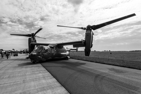 BERLIN, GERMANY - APRIL 25, 2018: VSTOL military transport aircraft Bell Boeing V-22 Osprey. US Air Force. Black and white. Exhibition ILA Berlin Air Show 2018