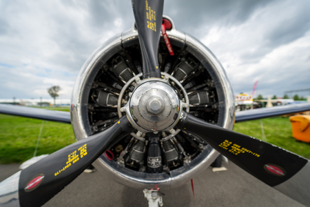 BERLIN, GERMANY - APRIL 25, 2018: Radial engine Wright R-1820-9 of the military trainer aircraft North American T-28B Trojan, close-up. United States Navy. Exhibition ILA Berlin Air Show 2018.