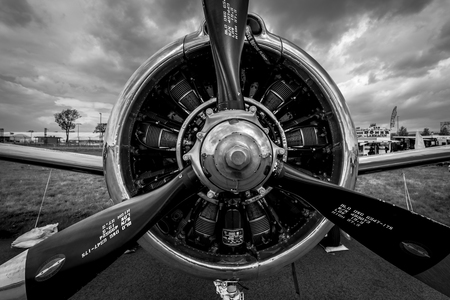 BERLIN, GERMANY - APRIL 25, 2018: Radial engine Wright R-1820-9 of the military trainer aircraft North American T-28B Trojan, close-up. US Navy.Black and white. Exhibition ILA Berlin Air Show 2018. Redakční