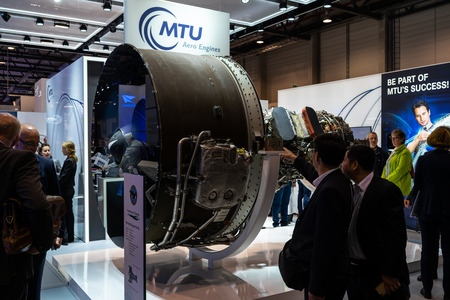 BERLIN, GERMANY - APRIL 25, 2018: The stand of MTU Aero Engines and high-bypass geared turbofan engine family Pratt & Whitney PW1000G. Exhibition ILA Berlin Air Show 2018.