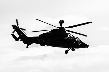BERLIN, GERMANY - APRIL 26, 2018: Demonstration flight of attack helicopter Eurocopter Tiger UHT. German Air Force. Black and white. Exhibition ILA Berlin Air Show 2018