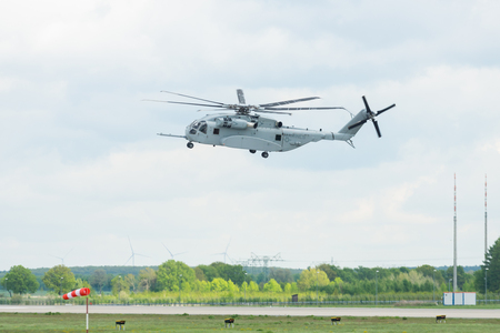 BERLIN, GERMANY - APRIL 26, 2018: Demonstration flight the heavy-lift cargo helicopter Sikorsky CH-53K King Stallion. Exhibition ILA Berlin Air Show 2018
