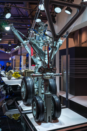 BERLIN - APRIL 26, 2018: Space Pavilion. Stand by Liebherr Group and samples of aircraft landing gear. Exhibition ILA Berlin Air Show 2018