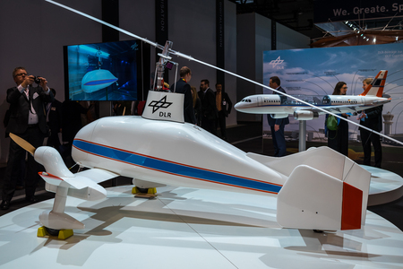 BERLIN - APRIL 26, 2018: Space Pavilion. Stand of DLR (German Aerospace Center). A cargo concept, autogyro, nicknamed Air Dolly. Exhibition ILA Berlin Air Show 2018 Editorial