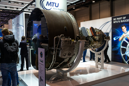 BERLIN - APRIL 26, 2018: The stand of MTU Aero Engines and high-bypass geared turbofan engine family Pratt & Whitney PW1000G. Exhibition ILA Berlin Air Show 2018. Editorial