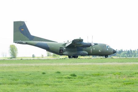 BERLIN - APRIL 26, 2018: Landing of the military transport aircraft Transall C-160D. German Air Force. Exhibition ILA Berlin Air Show 2018.