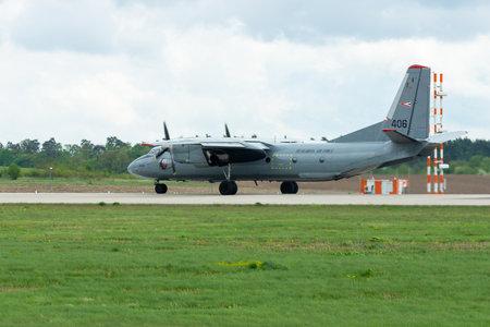 BERLIN - APRIL 26, 2018: Transport aircraft Antonov An-26. Hungarian Air Force. Exhibition ILA Berlin Air Show 2018.