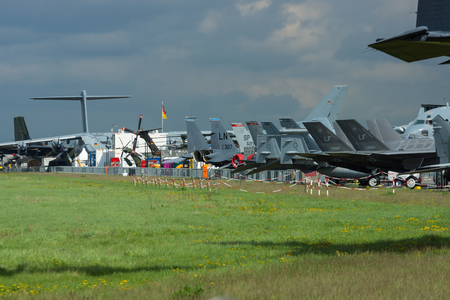 BERLIN - APRIL 26, 2018: Various military aircraft stand on the airfield. Exhibition ILA Berlin Air Show 2018 Editorial