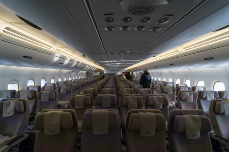 BERLIN - APRIL 26, 2018: Interior of an economy class of the world's largest aircraft Airbus A380. Emirates Airline. Exhibition ILA Berlin Air Show 2018 報道画像
