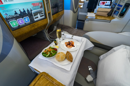 BERLIN - APRIL 26, 2018: Passengers menu of business class of the worlds largest aircraft Airbus A380. Emirates Airline. Exhibition ILA Berlin Air Show 2018