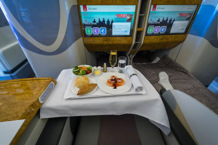 BERLIN - APRIL 26, 2018: Passenger's menu of business class of the world's largest aircraft Airbus A380. Emirates Airline. Exhibition ILA Berlin Air Show 2018