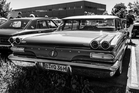 BERLIN - MAY 06, 2018: Full-size car Pontiac Catalina sedan, 1960. Rear view. Black and white. Oldtimertage Berlin-Brandenburg (31th Berlin-Brandenburg Oldtimer Day).
