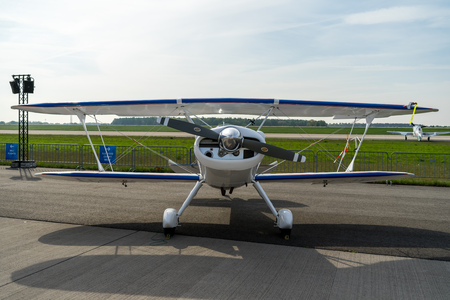 BERLIN - APRIL 27, 2018: Sport biplane Stolp Starduster Too SA300 on the airfield. Exhibition ILA Berlin Air Show 2018. Editorial