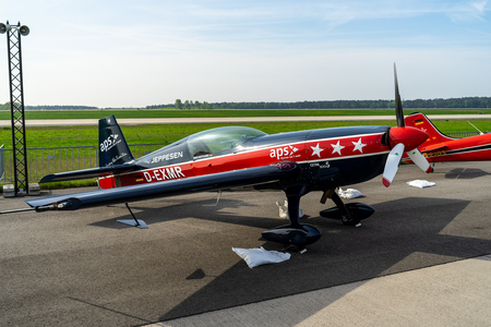 BERLIN - APRIL 27, 2018: Two-seat aerobatic monoplane Extra EA-300S (Extra Flugzeugbau EA300) on the airfield. Exhibition ILA Berlin Air Show 2018.