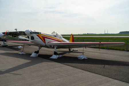 BERLIN - APRIL 27, 2018: Czech traineraerobatic aircraft Zlin Z-326 Trener Master on the airfield. Exhibition ILA Berlin Air Show 2018.