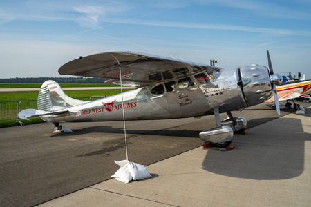 BERLIN - APRIL 27, 2018: Light personal and business aircraft Cessna 195A by Mid-West Airlines on the airfield. Exhibition ILA Berlin Air Show 2018.