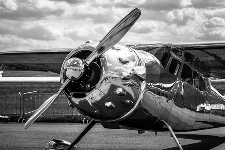 BERLIN - APRIL 27, 2018: Light personal and business aircraft Cessna 195A by Mid-West Airlines on the airfield. Black and white. Exhibition ILA Berlin Air Show 2018. Editorial
