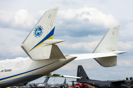 BERLIN - APRIL 27, 2018: Twin tail of the strategic airlift cargo aircraft Antonov An-225 Mriya. Close-up. Exhibition ILA Berlin Air Show 2018