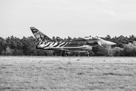 BERLIN, GERMANY - APRIL 27, 2018: Multirole fighter Eurofighter Typhoon on the runway. Black and white. Exhibition ILA Berlin Air Show 2018