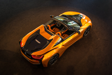 BERLIN - JUNE 09, 2018: Showroom. A plug-in hybrid sports car BMW i8 Roadster. View from above. Editorial