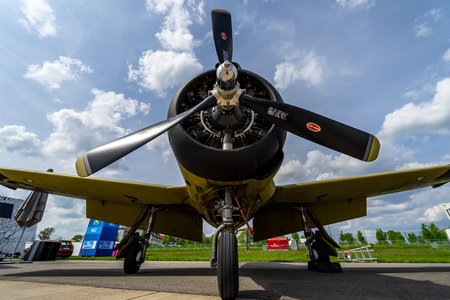BERLIN - APRIL 27, 2018: Light attacktrainer aircraft North American T-28B Trojan on the airfield. Flying Bulls Team. Exhibition ILA Berlin Air Show 2018.