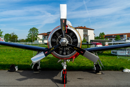 BERLIN - APRIL 27, 2018: Light attack  Trainer aircraft North American T-28B Trojan on the airfield. Exhibition ILA Berlin Air Show 2018.
