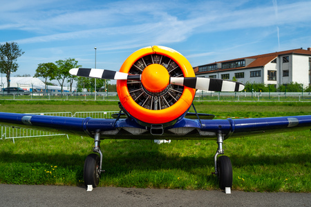 BERLIN - APRIL 27, 2018: A single-engined advanced trainer aircraft North American T-6 Texan on the airfield. Flying Bulls Team. Exhibition ILA Berlin Air Show 2018. Editorial