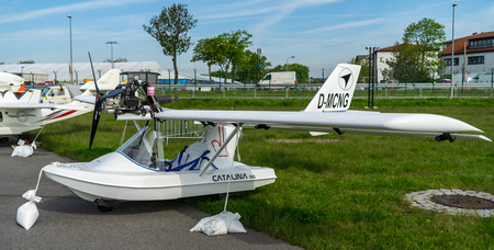 BERLIN - APRIL 27, 2018: Ultralight and light-sport amphibious flying boat Fly Synthesis Catalina NG on the airfield. Exhibition ILA Berlin Air Show 2018.