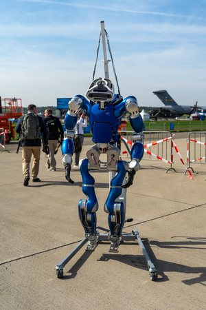 BERLIN - APRIL 27, 2018: The humanoid walking robot TORO (TOrque-controlled humanoid RObot) by the German Aerospace Center (DLR). Exhibition ILA Berlin Air Show 2018.
