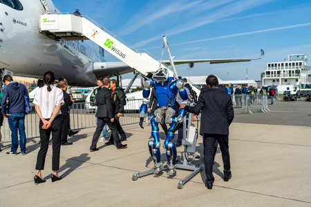 BERLIN - APRIL 27, 2018: The humanoid walking robot TORO (TOrque-controlled humanoid RObot) by the German Aerospace Center (DLR). Exhibition ILA Berlin Air Show 2018. Stock Photo - 103204196