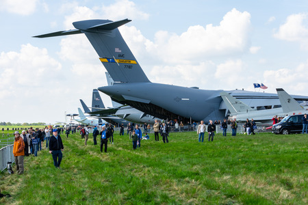 BERLIN - APRIL 27, 2018: Various aircraft and visitors on the airfield. Exhibition ILA Berlin Air Show 2018. Editorial