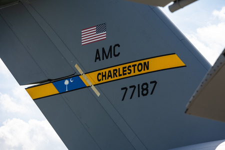 BERLIN - APRIL 27, 2018: The empennage of a strategic and tactical airliner Boeing C-17 Globemaster III. US Air Force. Joint base Charleston. Exhibition ILA Berlin Air Show 2018.