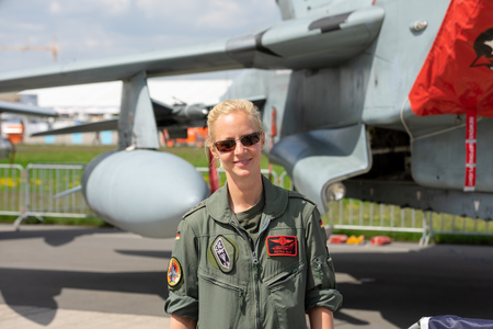 BERLIN - APRIL 27, 2018: The pilot (woman) of the German Air Force. Exhibition ILA Berlin Air Show 2018.