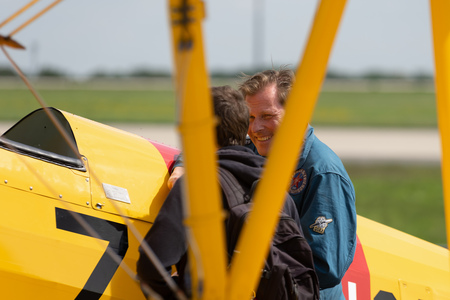 BERLIN - APRIL 27, 2018: The visitor talks to the pilot of the biplane trainer Boeing-Stearman Model 75 Kaydet. Exhibition ILA Berlin Air Show 2018. Editorial