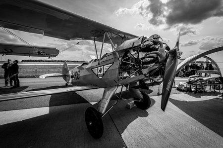 BERLIN - APRIL 27, 2018: Biplane trainer Focke-Wulf Fw 44J Stieglitz (Goldfinch). Black and white. Exhibition ILA Berlin Air Show 2018. Editorial