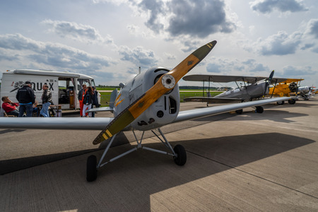 BERLIN - APRIL 27, 2018: Two-seat sport/training monoplane Bucker Bu 180 Student. Exhibition ILA Berlin Air Show 2018.